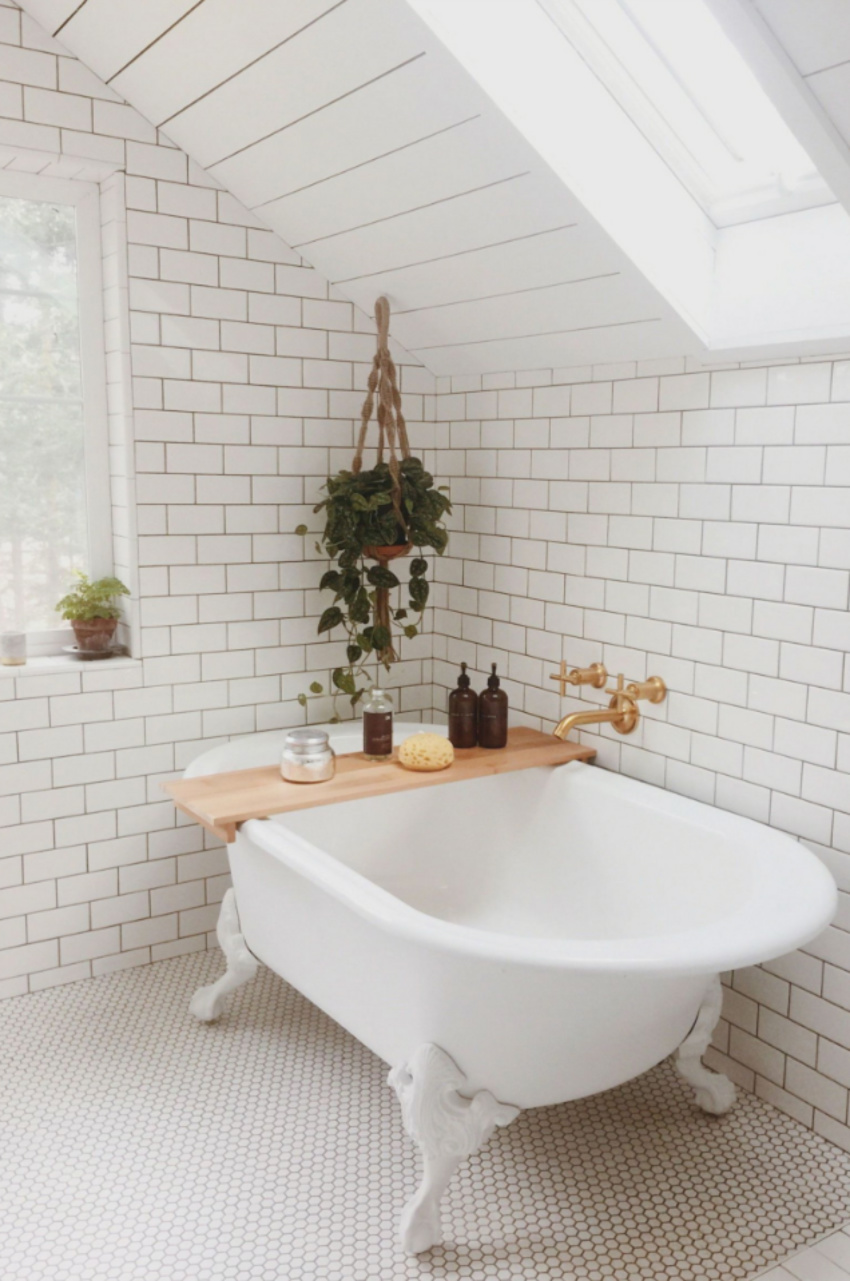 Tile work covers most bathrooms. Source: Country Living