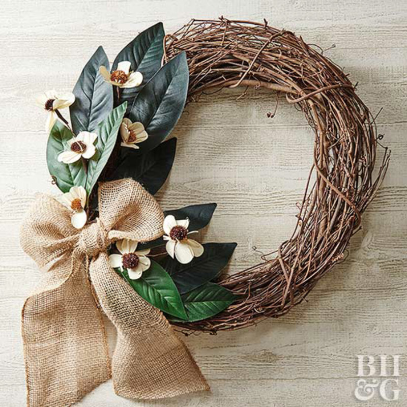 Decorate your front door with a lovely wreath. Source: BHG