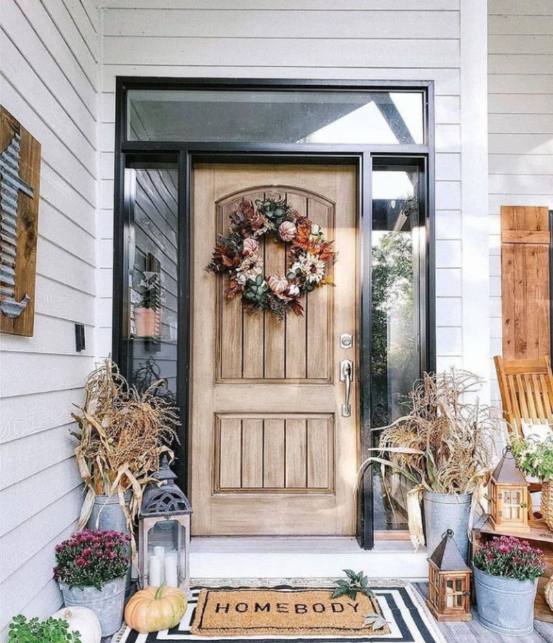 Decorate the front door with Fall-inspired decor. Source: Real Homes