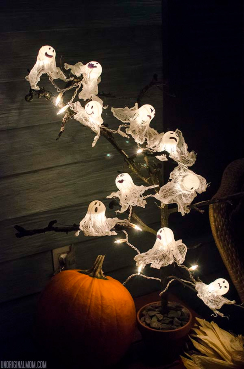 Create a bunch of cheerfully bright ghosts to watch your front porch. Source: Unoriginal Mom