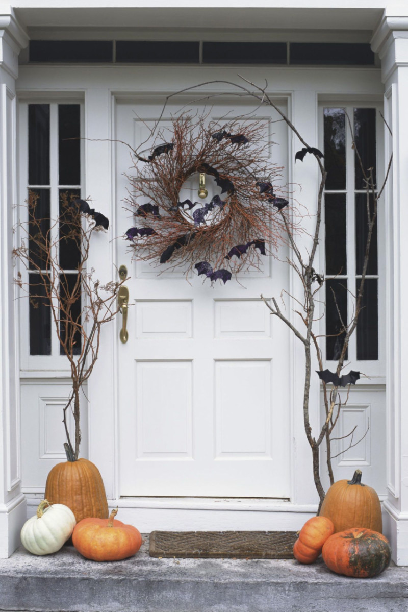 The front door can be made to resemble a spooky forest. Source: Country Living