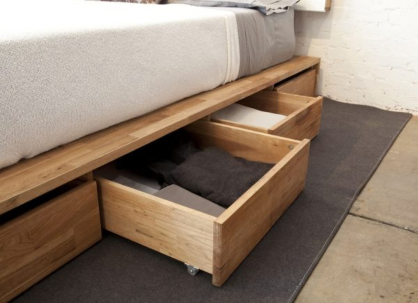 You can store a lot of things under the bed, so take advantage! Source: Make Space