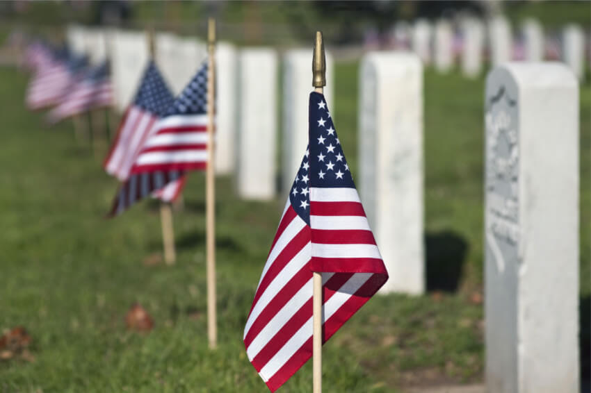 Decorate a local veterans cemetery with flowers to honor their memories.