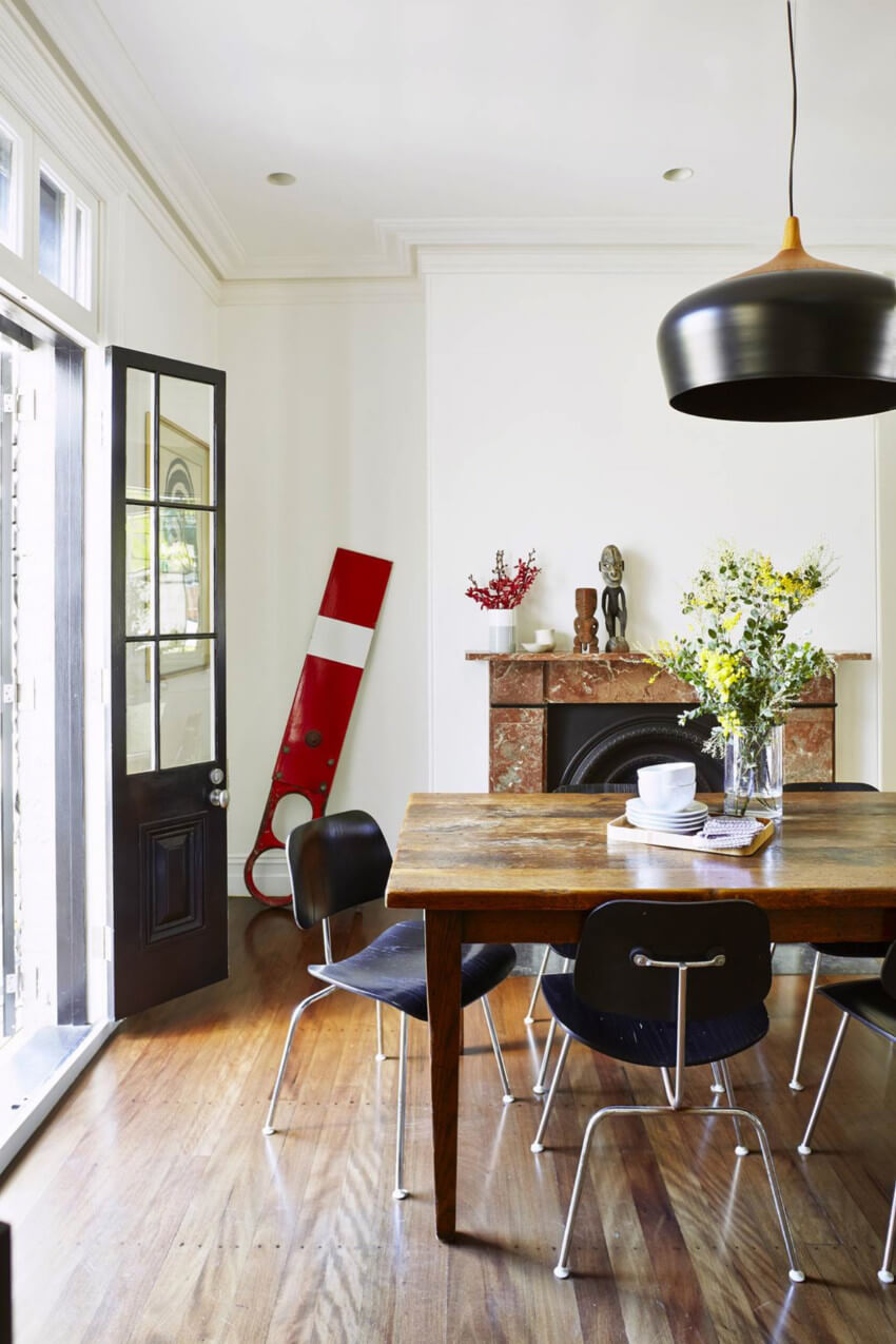 Mix an old table with new chairs and a modern light fixture.