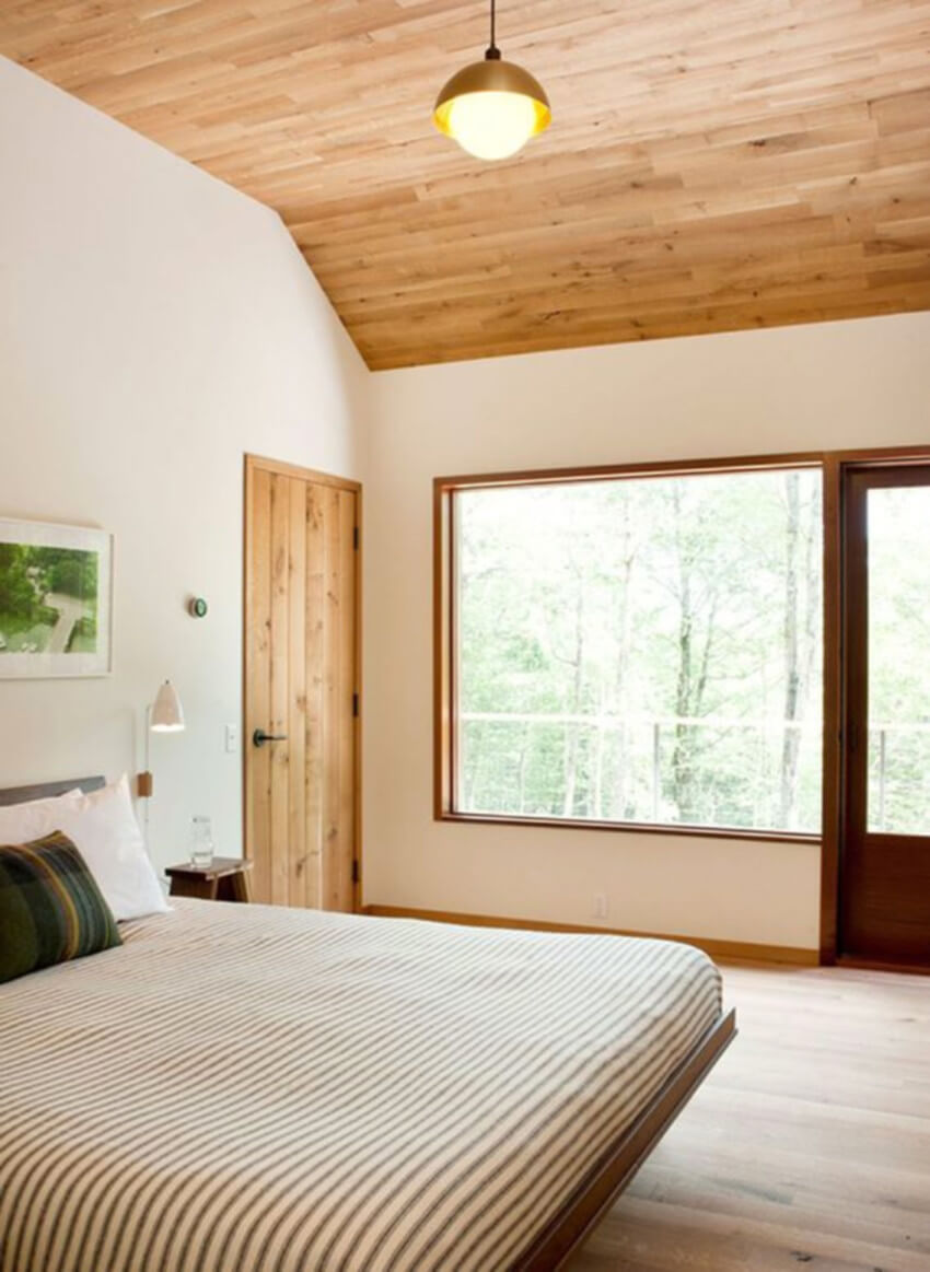 Wooden planks look incredible in a master bedroom.