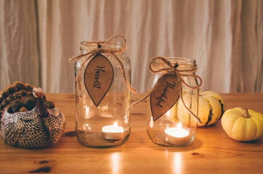 Mason jars and votive candles go together quite well! Source: Harper's Bazar