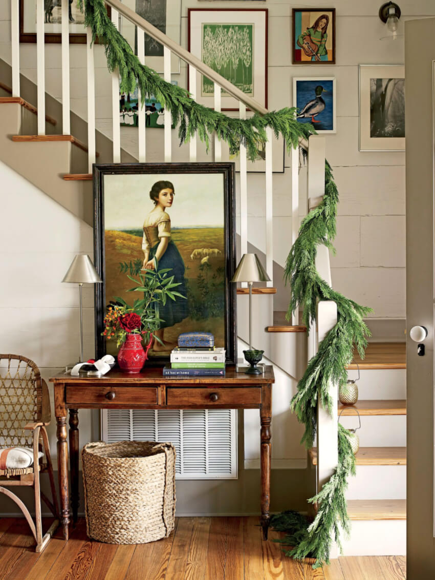 The stairway is a great place to decorate. Source: Southern Living