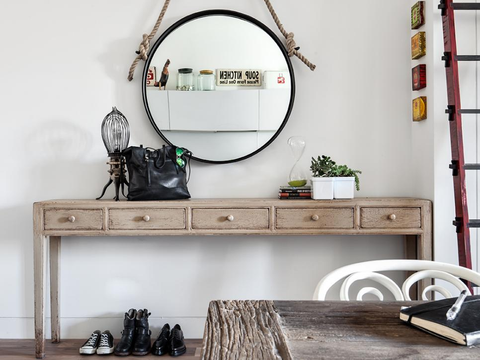 A mirror is very practical on the entryway. Source: HGTV