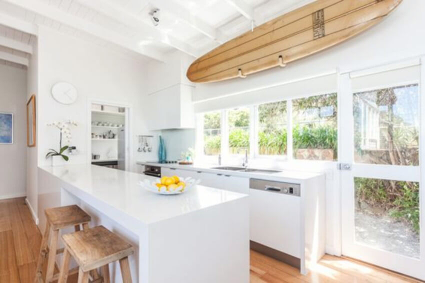 A surfboard is the kitchen is totally unique.