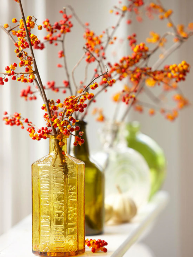 Glass bottles can be very charming to hold foliage. Source: Midwest Living