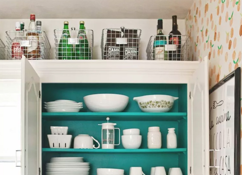 You can store bottles or special pots on top of the cabinets. Source: The Spruce