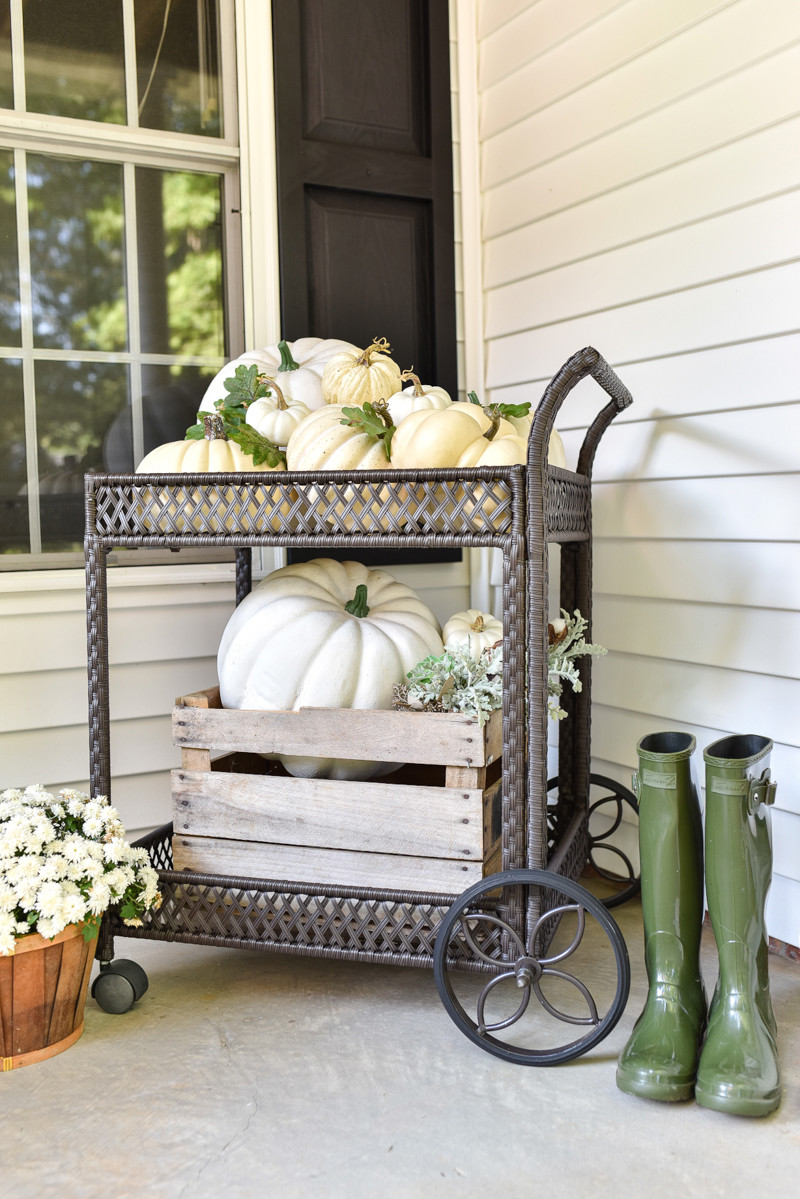 Add a farmhouse touch to your porch with a pumpkin cart. Source: Home Stories A to Z
