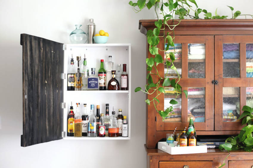 Even a small cabinet can double as a mini bar! Source: A Beautiful Mess