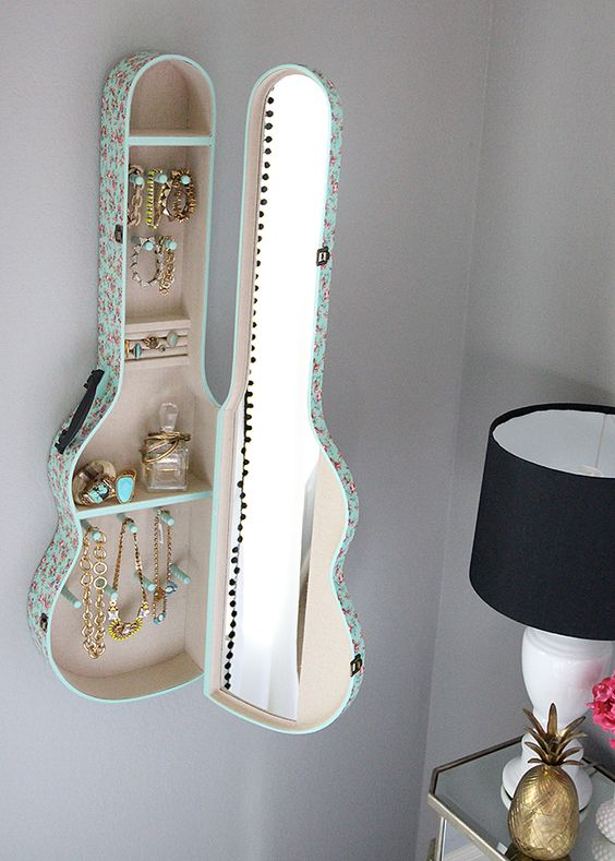 Guitar cases can also be used as shelves! Source: Crafty Morning