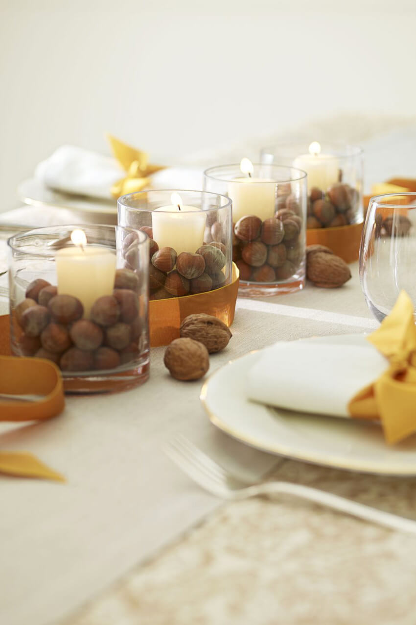 A simple setup with votive candles and nuts! Source: House Beautiful