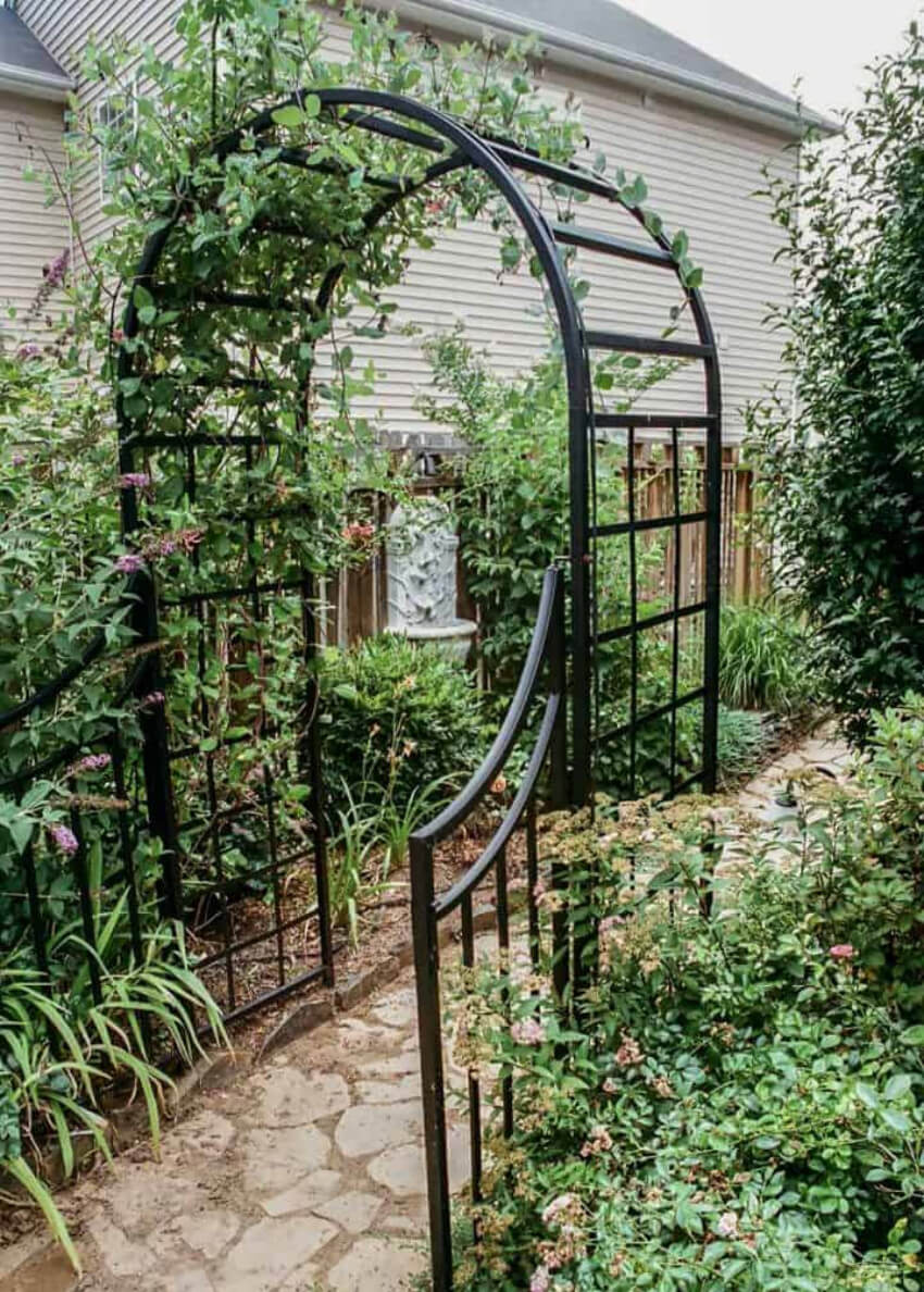 This metal arch entrance to the garden is gorgeous.