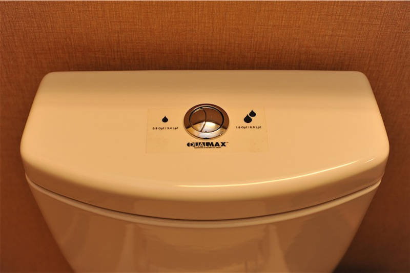 how does the dual-flush toilet work