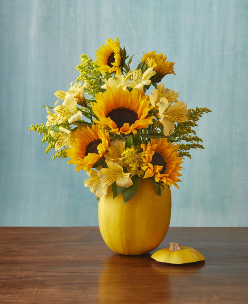 Bring life to your home with sunflowers in a pumpkin. Source: The Pioneer Woman