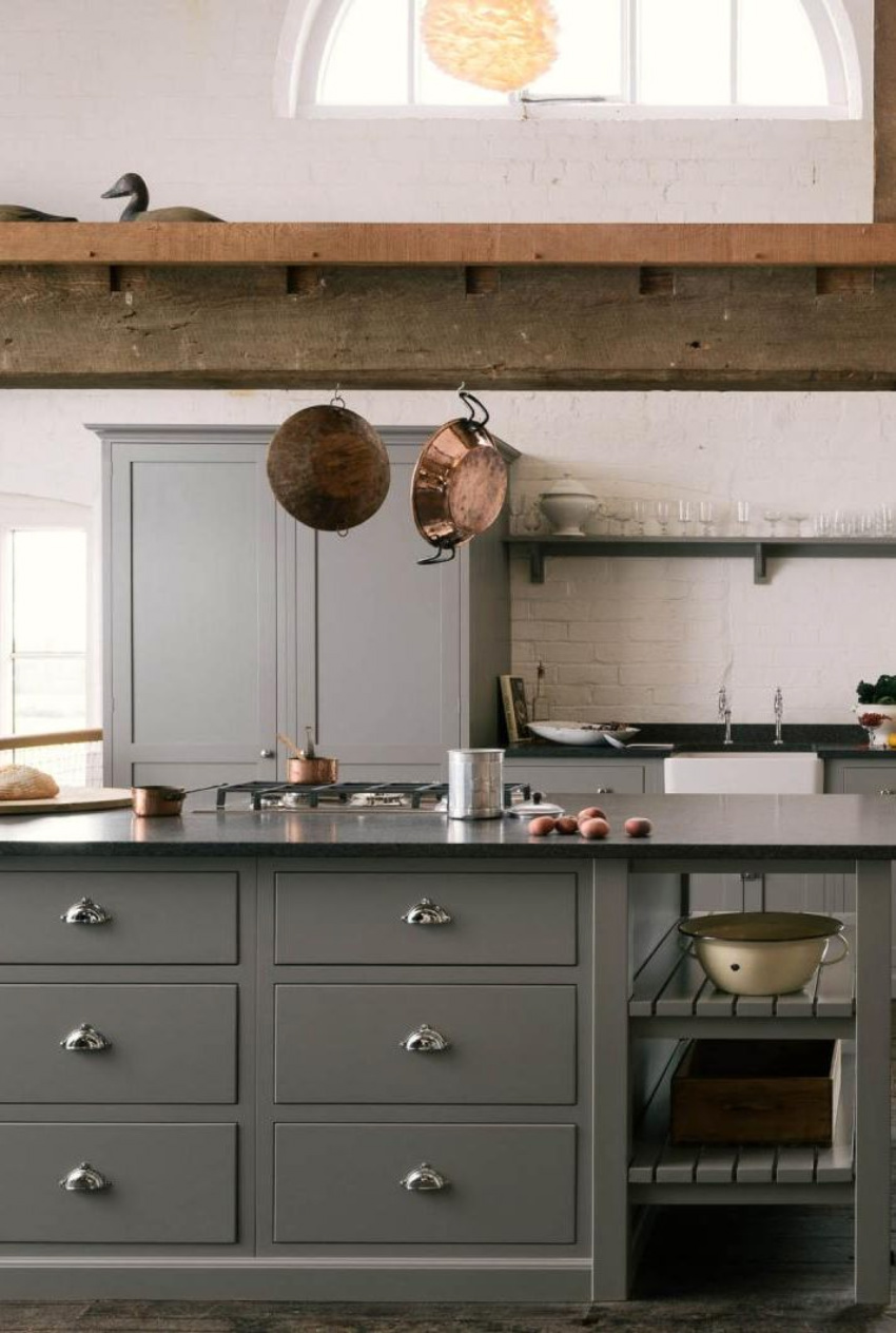 Hanging pans is a great way to save space in the kitchen. Source: House Beautiful